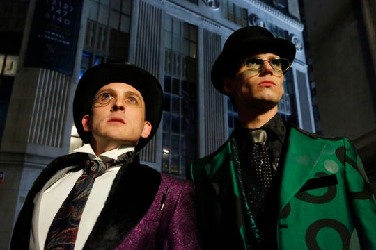 """Penguin (Robin Lord Taylor, left) and Riddler (Cory Michael Smith) get some familiar threads to old-school Bat-fans in the final episode of """"Gotham."""""""
