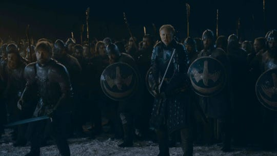 Jaime Lannister (Nikolaj Coster-Waldau), left foreground, and noble Brienne of Tarth (Gwendoline Christie) lead the Westerosi forces into battle in Sunday's episode of 'Game of Thrones.'