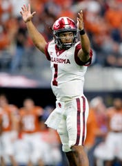 Oklahoma Sooners quarterback Kyler Murray (1) celebrates during the game against the Texas Longhorns in the Big 12 Championship game at AT&T Stadium.