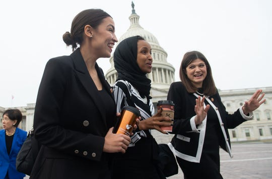 TOPSHOT - US Representative Alexandria Ocasio-Cortez, Democrat of New York; US Representative Ilhan Omar (C), Democrat of Minnesota; and US Representative Haley Stevens (R), Democrat of Michigan, arrive for a photo opportunity with the female House Democratic members of the 116th Congress outside the US Capitol in Washington, DC, January 4, 2019. (Photo by SAUL LOEB / AFP)SAUL LOEB/AFP/Getty Images ORG XMIT: House Spe ORIG FILE ID: AFP_1BZ2JO