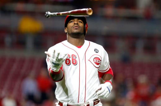 April 23: Reds outfielder Yasiel Puig throws his bat after hitting a sac fly against the Braves.