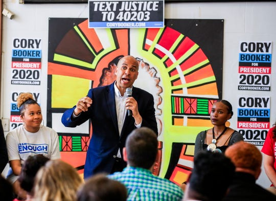 Democratic Presidential Candidate Cory Booker participates in a discussion with gun violence prevention advocates at Coffee Makes You Black in Milwaukee, Wisconsin. Booker called Tampa's newly-elected Jane Castor to congratulate her on history-making victory.