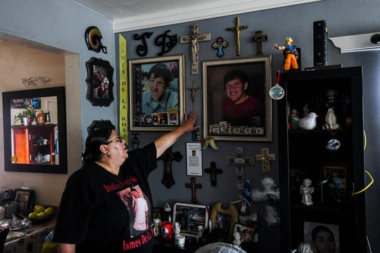 Leticia de la Rosa points to old images of her son James inside of her Bakersfield home.