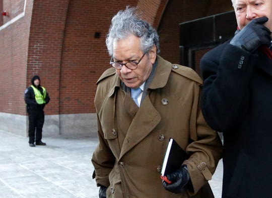 Insys Therapeutics founder John Kapoor leaves federal court in Boston on Jan. 30.