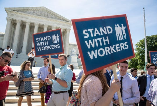 The Supreme Court ruled 5-4 Wednesday that an ambiguous contract does not allow workers to band together in arbitration disputes.