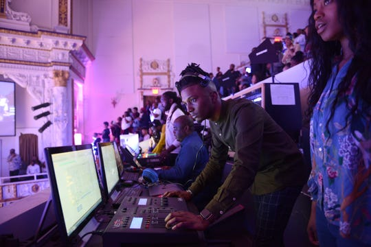The technical crew is seen doing a live stream and working the lights and other technology for parishioners at First Corinthian Baptist Church in Harlem, New York City, NY.