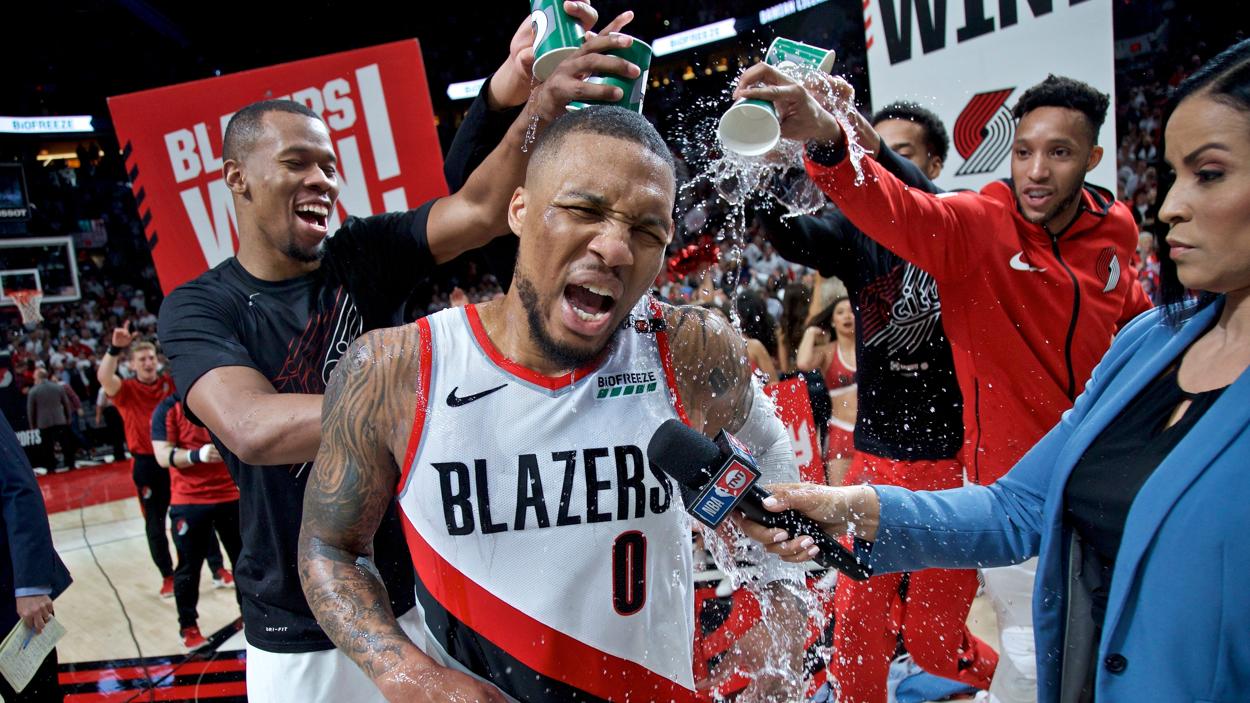 Portland Trail Blazers players pour water on Damian Lillard after his game-winner against Oklahoma City.