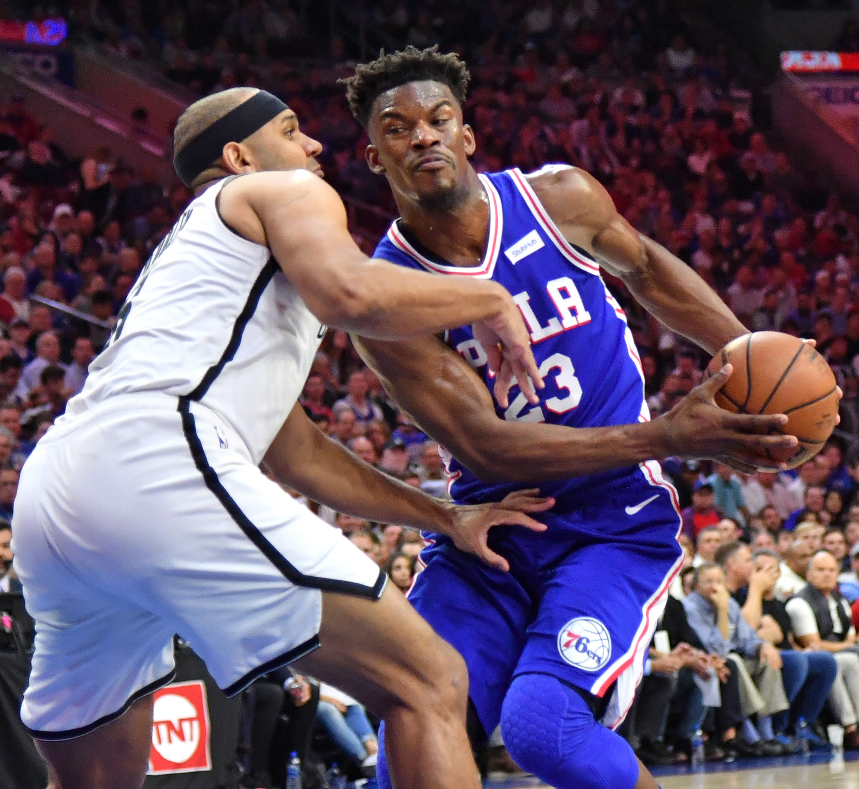 April 23:  Philadelphia 76ers guard Jimmy Butler drives to the basket against Brooklyn Nets forward Jared Dudley during Game 5 at Wells Fargo Center. The 76ers eliminated the Nets with a 122-100 win.