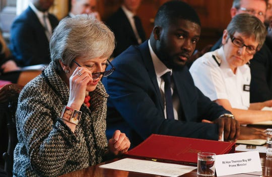 From left, Britain's Prime Minister Theresa May, Youth Justice Board co-chair Roy Sefa-Attakora and Metropolitan Police commissioner Cressida Dick take part in a serious youth violence summit in Downing Street, London, Monday April 1, 2019. The summit includes leaders from major British cities and other involved agencies, in response to an escalation of knife-related crime in Britain.