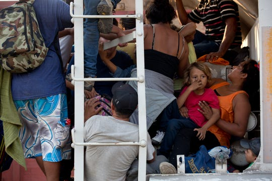 """Central American migrants cram into a freight train during their journey toward the U.S.-Mexico border, in Ixtepec, Oaxaca State, Mexico, Tuesday, April 23, 2019. """"They're riding the train again, that's a fact,"""" said migrant rights activist Rev. Alejandro Solalinde, who's shelter now houses about 300 train-riding migrants. """"It's going to go back to the way it was, the (Mexican) government doesn't want them to be seen. (AP Photo/Moises Castillo)"""