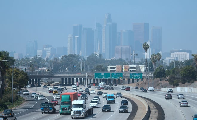 Downtown Los Angeles on a hazy morning on Sept. 21, 2018. Eighty-seven days of smog this summer has made it the longest stretch of bad air in at least 20 years, according to state monitoring data, the latest sign southern California's efforts to battle smog after decades of dramatic improvement are faltering.