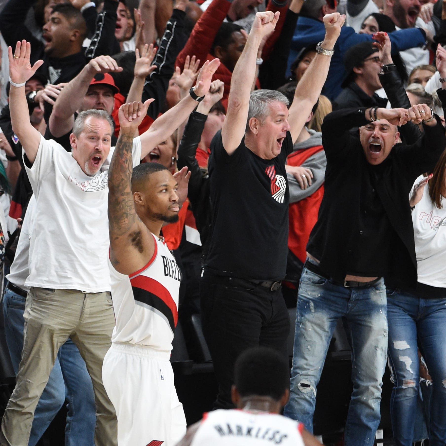 Damian Lillard and fans react after his...