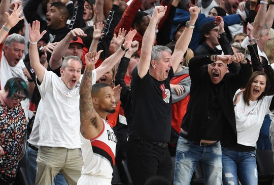 Damian Lillard and fans react after his game-winning buzzer-beater.