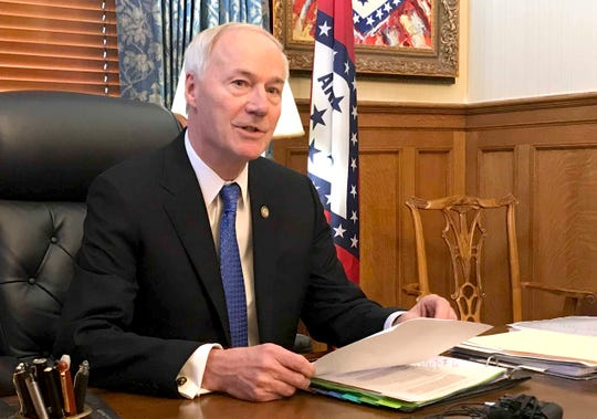 "Arkansas Gov. Asa Hutchinson, speaking in his office at the state Capitol in Little Rock, Ark., on April 10, 2019, tells reporters he'll sign legislation cutting off funding to ""sanctuary cities"" that don't cooperate with federal immigration authorities."