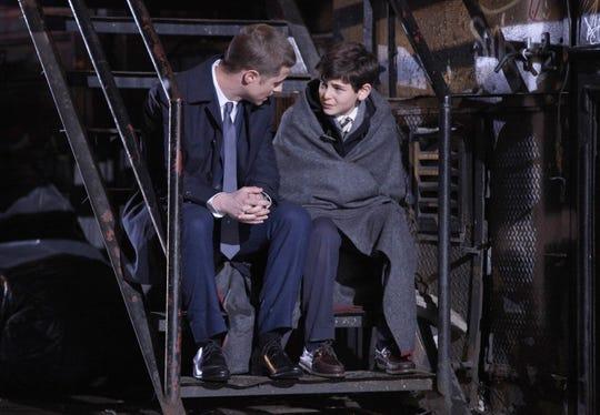 "Jim Gordon (Ben McKenzie, left) comforts Bruce Wayne (David Mazouz) after his parents are murdered in the ""Gotham"" pilot."