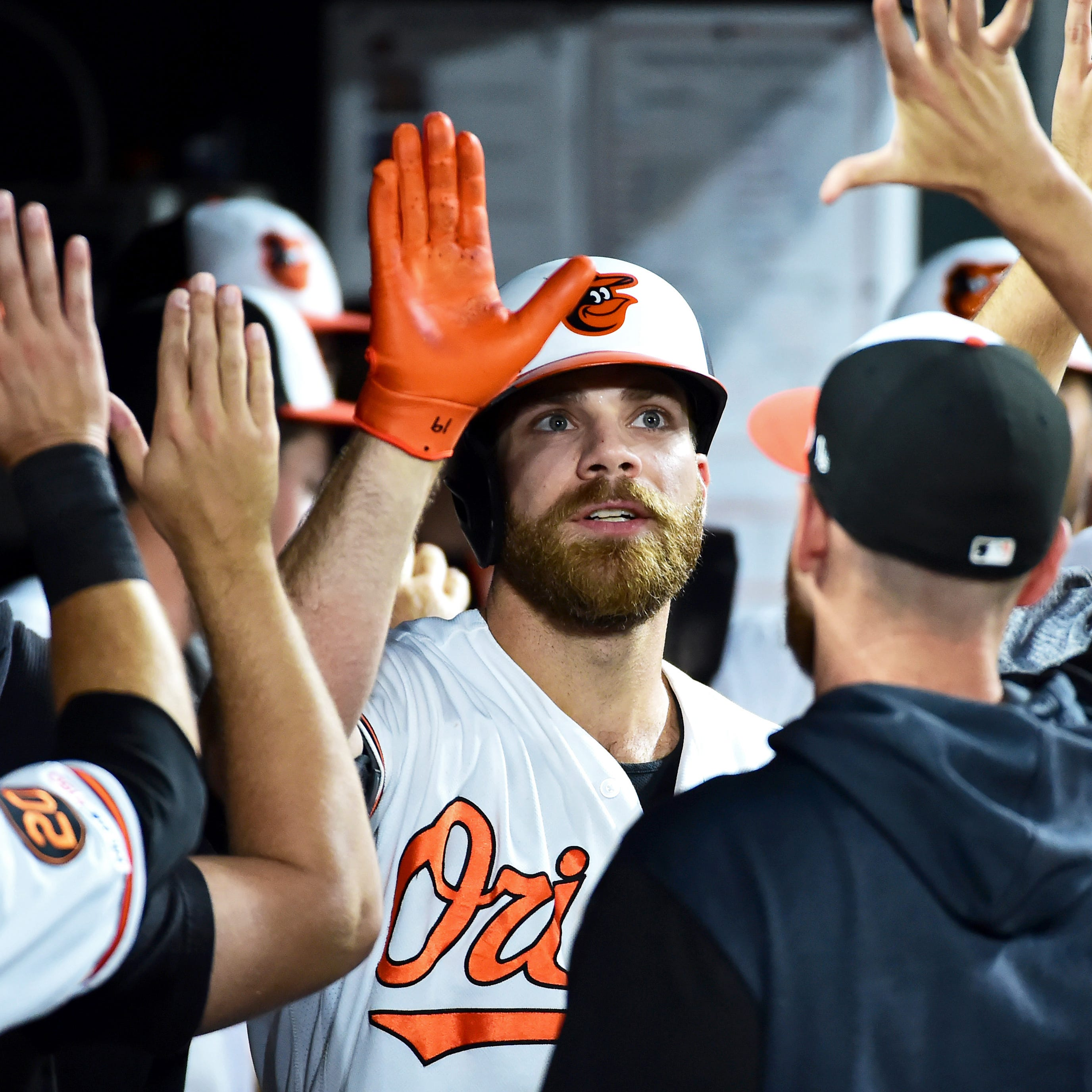 Chris Davis is congratulated after hitting a home...