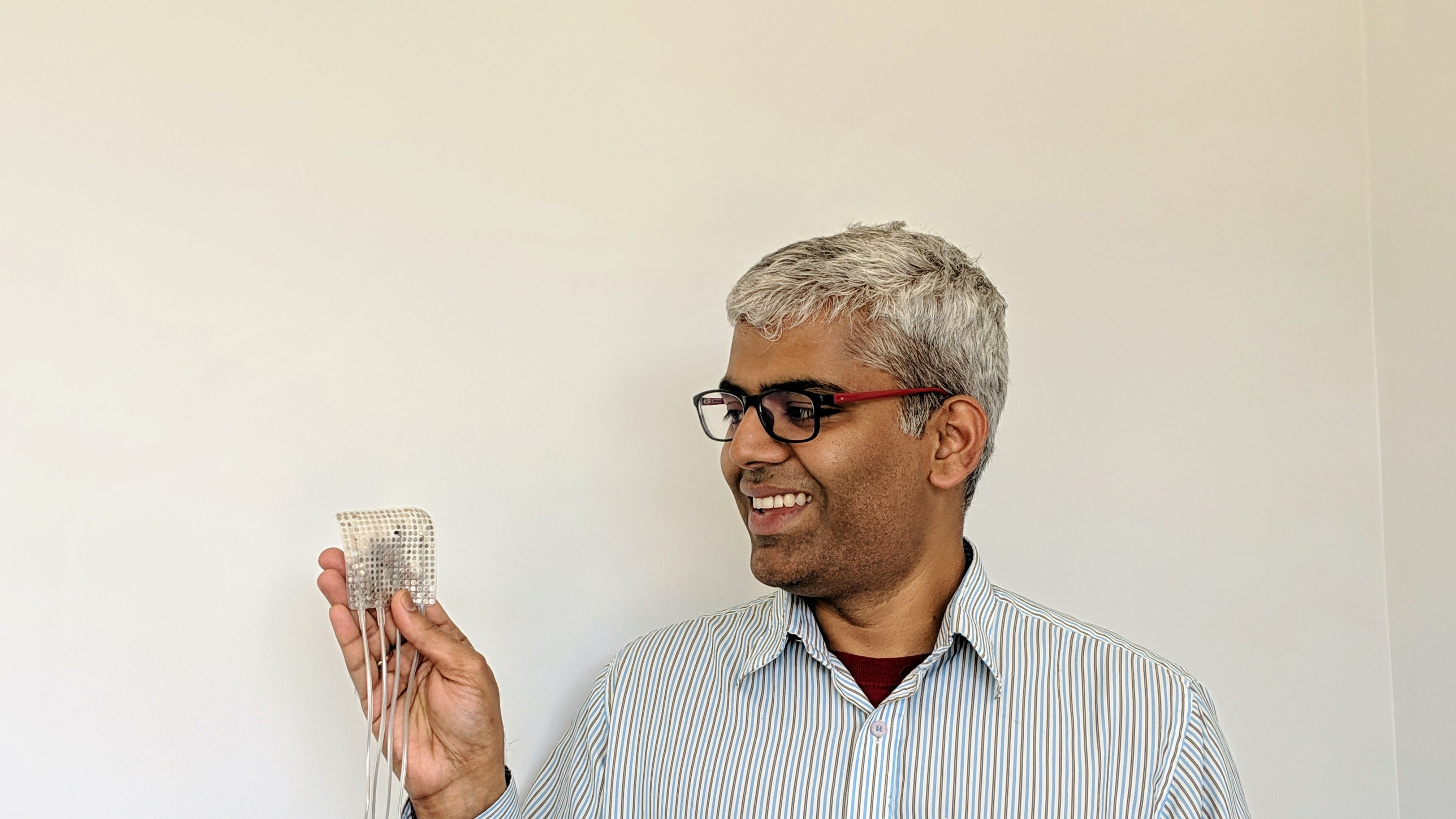 Study author Gopala Anumanchipalli holds an example of the gadget that could literally give voice to the voiceless.