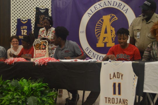 ASH basketball players Nuney Griffin (left) and Brit White signed with Baton Rouge Community College Wednesday.