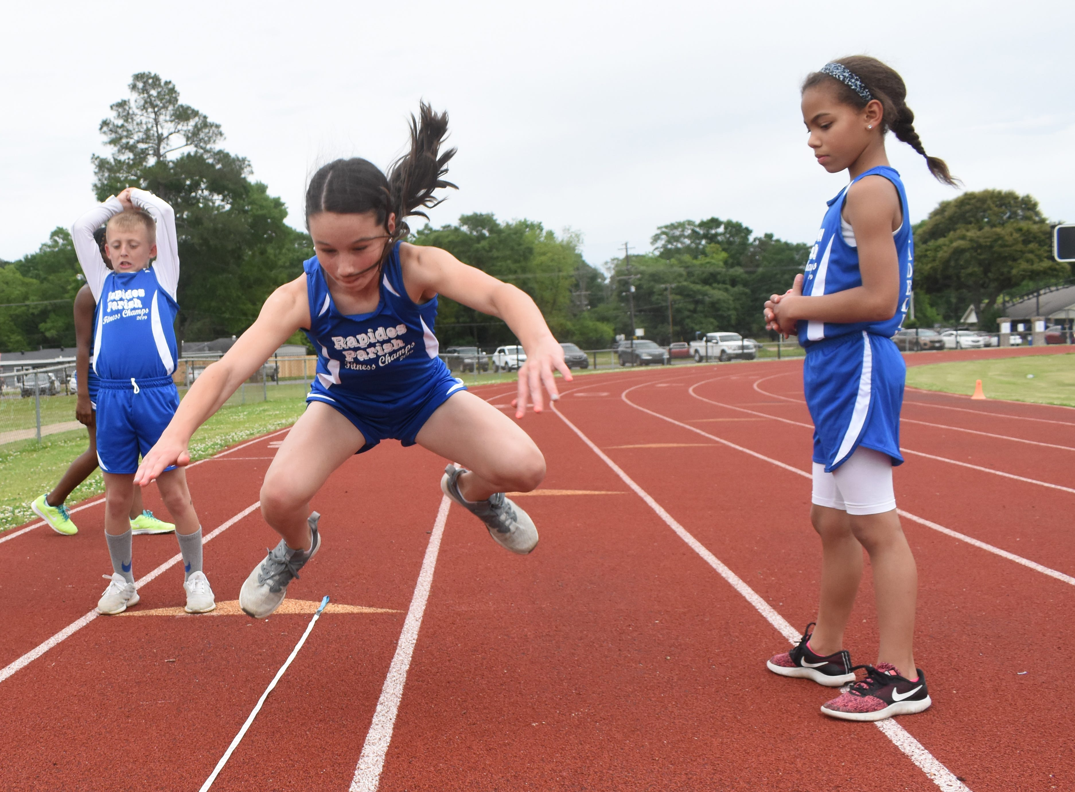Aubree Davis of Ball Elementary School complete a long jump. Aubree is part the 2019 Rapides Parish Fitness Team. Aubree and five other Rapides Parish elementary school students will compete in the 2019 State Championship Fitness Meet to be held Saturday, April 27, 2019 at Alexandria Senior High School. The meet is part of the Governor's Council on Fitness and Sports. Students from throughout Louisiana will compete in seven events: 50-yard dash, sit and reach, pull-ups,  shuttle run, curl-ups (sit-ups), standing long jump, and the 600-yard run. For the past three years, the Rapides Parish Fitness Team has placed first at the meet. Dean was the highest scoring boy last year and won the title of 2018 Mr. Fitness for the State of Louisiana. The meet will be from 10 a.m. to 2 p.m.