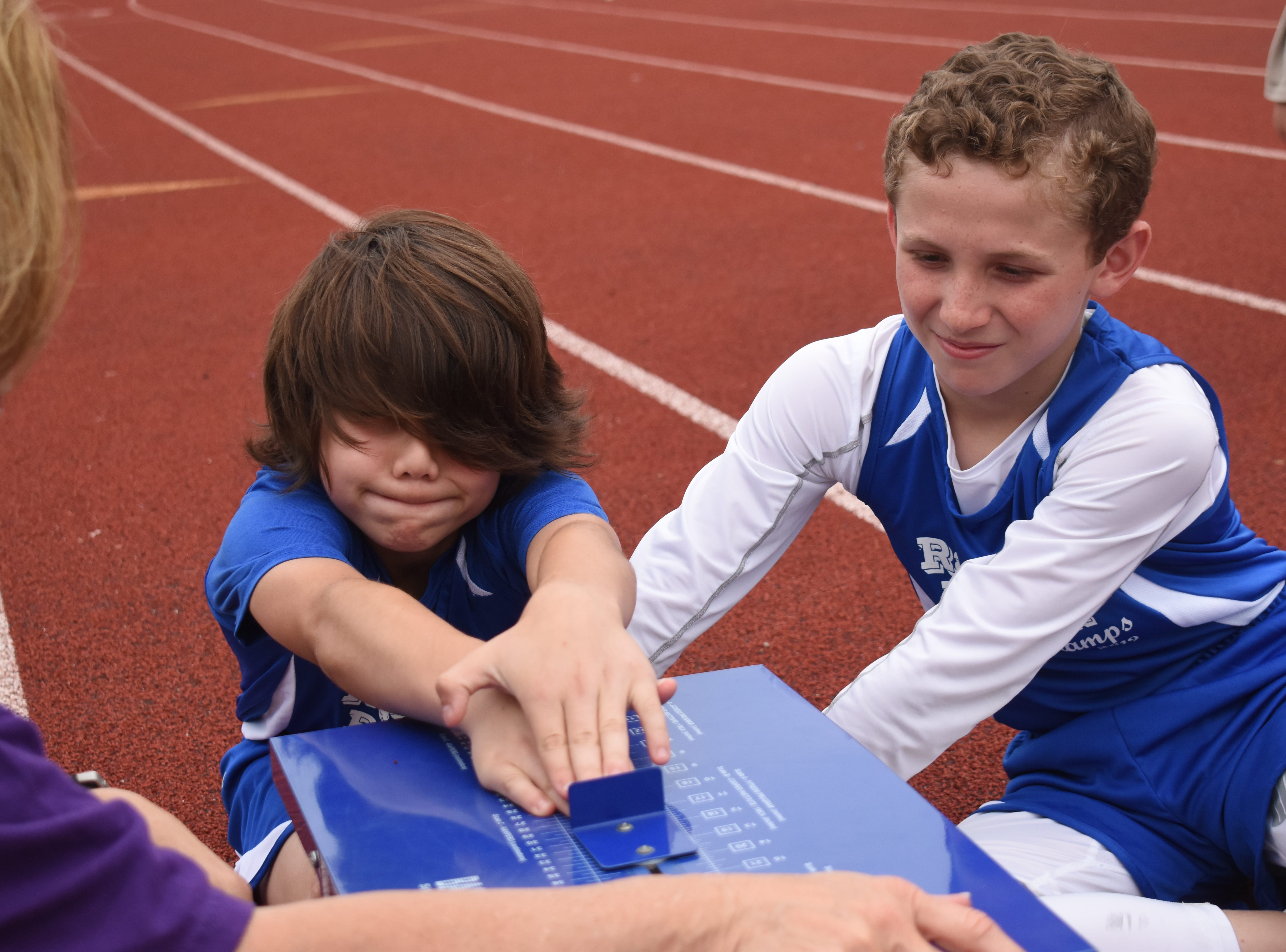 Bryce Warthen (left) of Hayden Lawrence Elementary School, completes a sit and reach. Bryce along with Jacob Dean of Nachman Elementary School are part the 2019 Rapides Parish Fitness Team. They and four other Rapides Parish elementary school students will compete in the 2019 State Championship Fitness Meet to be held Saturday, April 27, 2019 at Alexandria Senior High School. The meet is part of the Governor's Council on Fitness and Sports. Students from throughout Louisiana will compete in seven events: 50-yard dash, sit and reach, pull-ups,  shuttle run, curl-ups (sit-ups), standing long jump, and the 600-yard run. For the past three years, the Rapides Parish Fitness Team has placed first at the meet. Dean was the highest scoring boy last year and won the title of 2018 Mr. Fitness for the State of Louisiana. The meet will be from 10 a.m. to 2 p.m.