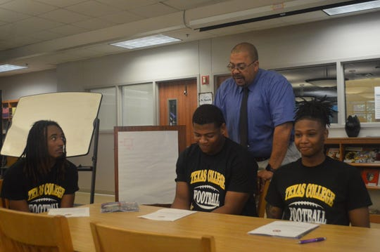 Peabody football players Kenneth Williams (left), Devetrius Lotts and Malik Edwards signed with Texas College last week.