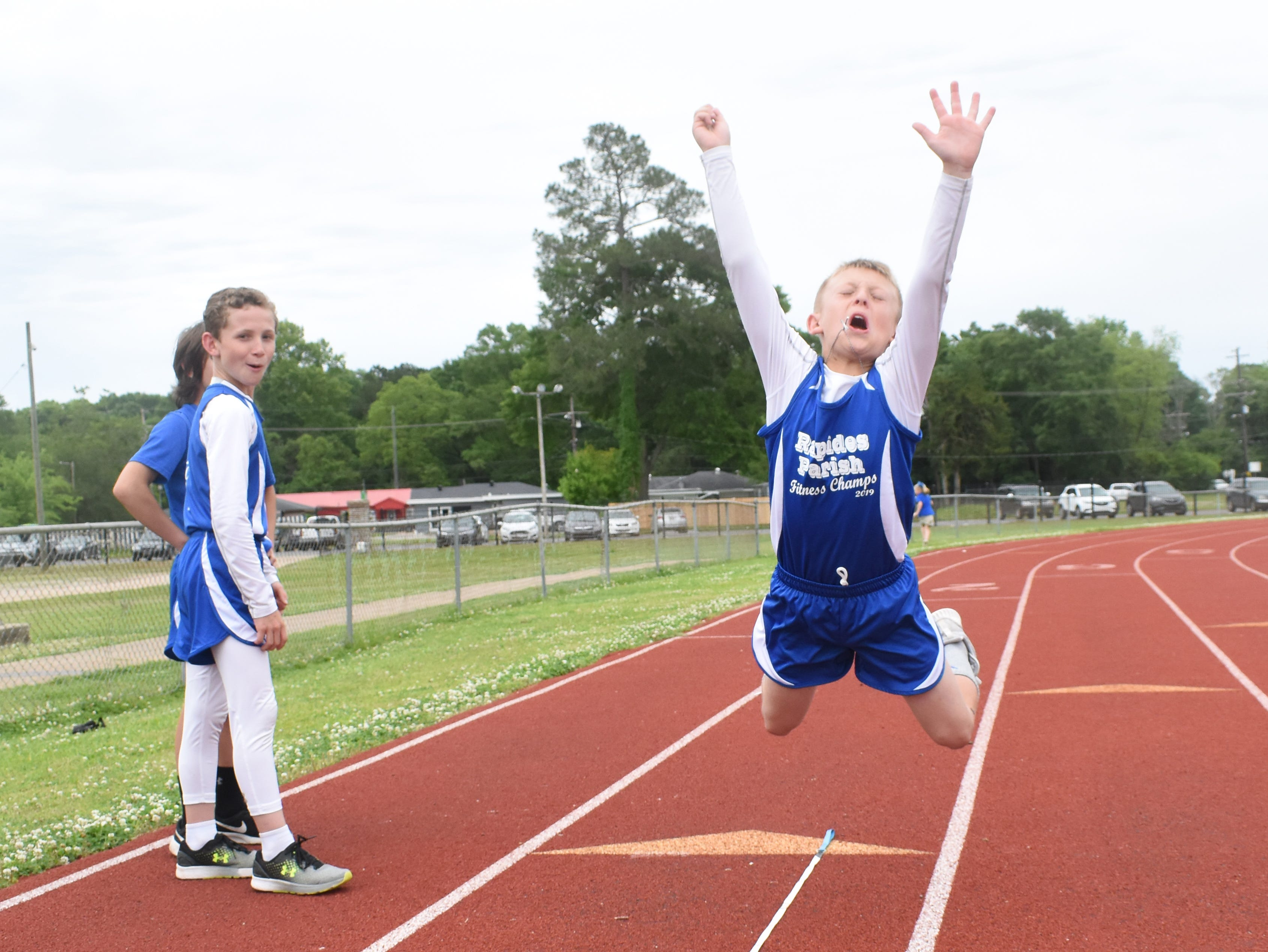 Jaxon Ross (left) of Nachman Elementary School complete a long jump. Jaxon is part the 2019 Rapides Parish Fitness Team. Jaxon and five other Rapides Parish elementary school students will compete in the 2019 State Championship Fitness Meet to be held Saturday, April 27, 2019 at Alexandria Senior High School. The meet is part of the Governor's Council on Fitness and Sports. Students from throughout Louisiana will compete in seven events: 50-yard dash, sit and reach, pull-ups,  shuttle run, curl-ups (sit-ups), standing long jump, and the 600-yard run. For the past three years, the Rapides Parish Fitness Team has placed first at the meet. Dean was the highest scoring boy last year and won the title of 2018 Mr. Fitness for the State of Louisiana. The meet will be from 10 a.m. to 2 p.m.