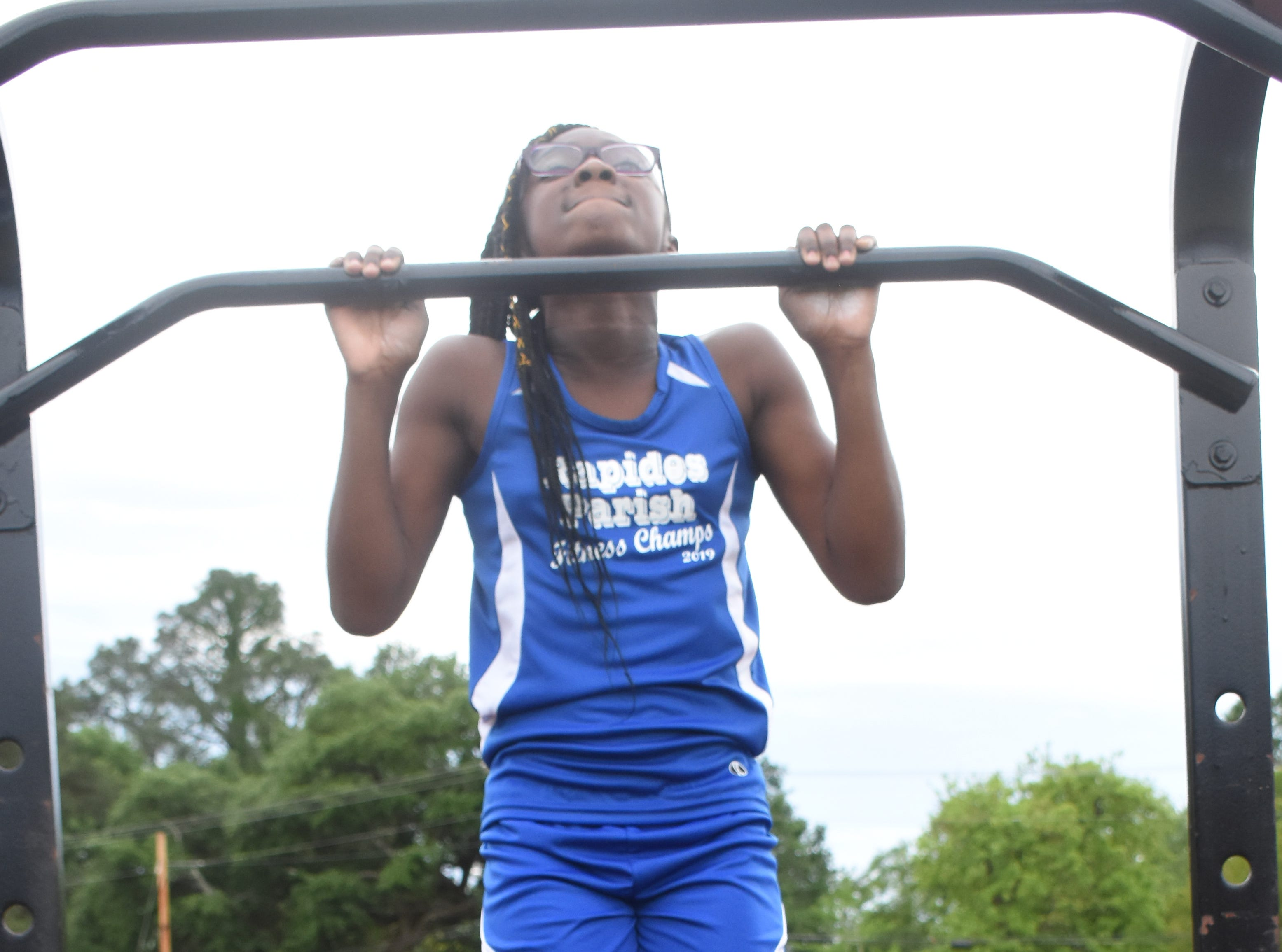 Amari Dupar of Cherokee Elementary School does pull-ups. Amari and five other Rapides Parish elementary school students will compete in the 2019 State Championship Fitness Meet to be held Saturday, April 27, 2019 at Alexandria Senior High School. The meet is part of the Governor's Council on Fitness and Sports. Students from throughout Louisiana will compete in seven events: 50-yard dash, sit and reach, pull-ups,  shuttle run, curl-ups (sit-ups), standing long jump, and the 600-yard run. For the past three years, the Rapides Parish Fitness Team has placed first at the meet. Dean was the highest scoring boy last year and won the title of 2018 Mr. Fitness for the State of Louisiana. The meet will be from 10 a.m. to 2 p.m.