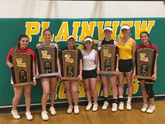 Plainview softball players showcase the multiple titles they have won in different sports since 2016. From left are: Laney Brouillette, Aryn Johnson, Madison Pippen, Kloe Fee, Alex Harrison, Kinsley Ashworth and Millie Thompson. Not pictured are Allie Willis and Abigail Pippen.