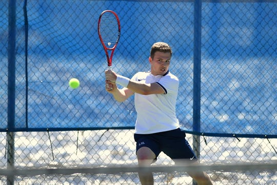 Cade Francour leads the Lawrence tennis team with a 13-6 singles record.