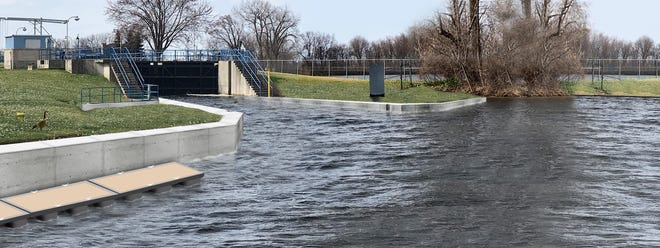 A rendering shows the proposed channel for an electric barrier at the downstream end of the Menasha lock.
