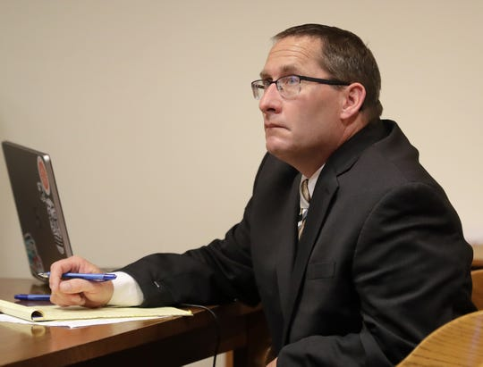 Jason LaVigne sits at the defense table during the first day of his jury trial Tuesday in Outagamie County. LaVigne is a former Little Chute High School teacher accused of sexually assaulting a 14-year-old student nearly two decades ago.