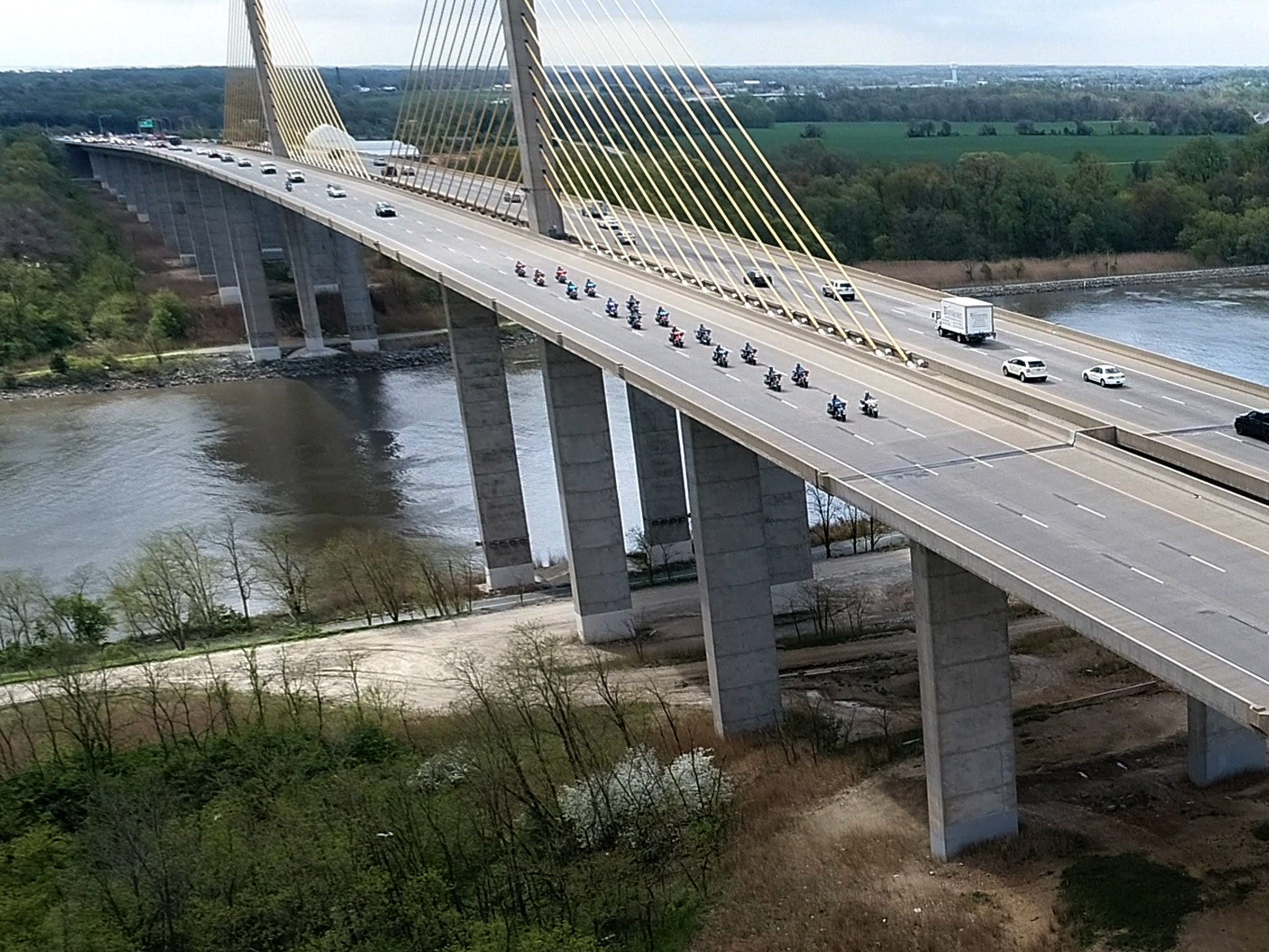 The funeral procession for Marine Staff Sergeant Christopher Slutman heads north along Rt. 1 over The Senator William B. Roth Jr. Bridge in St. Georges, DE, Monday, April 22, 2019.