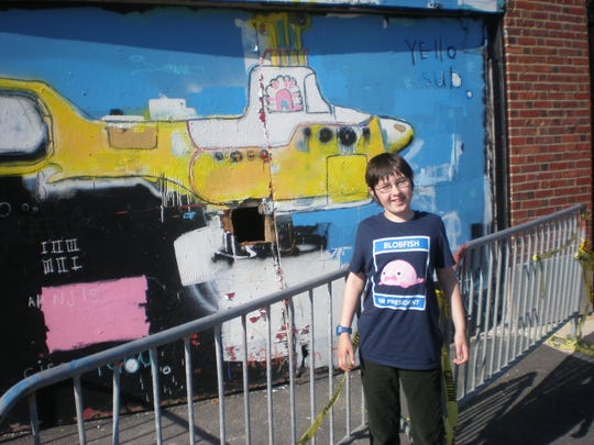 Youngest Bergmann mugging in front of the Yellow Submarine wall art in Asbury Park in 2017.