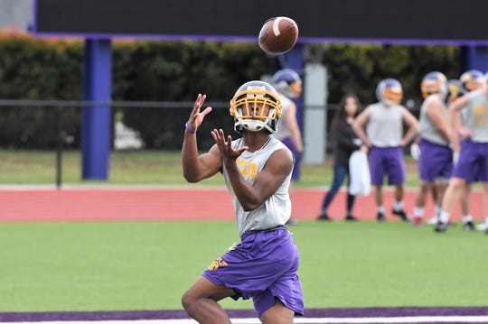 Wylie's Jahzair George looks in a pass during workouts this week.