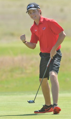 Cooper freshman Karson Grigsby reacts to sinking a putt for birdie on No. 4 during the final round of the Region I-5A boys golf tournament Thursday at Texas Tech's The Rawls Course in Lubbock.