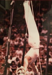 Abilene High graduate Mark Oates competes on the rings. Oates was the 1981 Class 5A all-around state champion, 1983 NCAA vault champion, 1985 USA floor and vault champion. Oates was also part of the US national team in 1988.