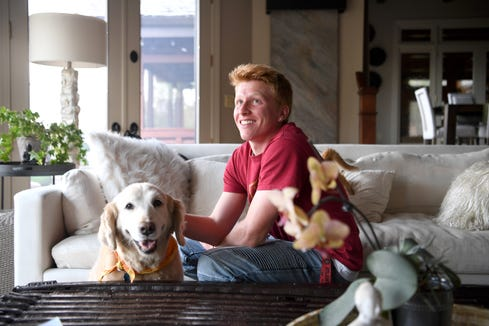 Michael Wilkerson, 17, pets the family dog, Gracie, at his Asheville home on April 18, 2019. Wilkerson is leaving his junior year at Asheville High School to play soccer for the Atlanta United FC on a development team for the city's Major League Soccer team, with the goal of playing professional soccer. Gracie is also making the trip to Atlanta.