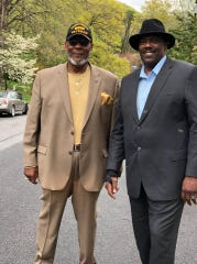Long-time Asheville police officer Walt Robertson, left, with Quentin Miller during his successful campaign to become Buncombe County's first African-American sheriff. Robertson who died April 25 was the first city's first black officer to rise to the rank of lieutenant.