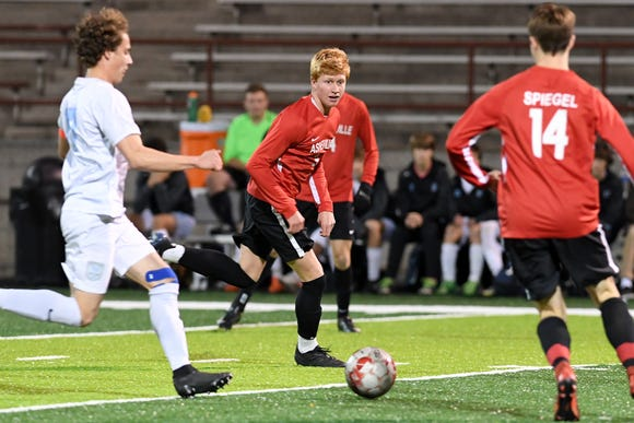 Michael Wilkerson runs for a ball during a playoff game at Asheville High School on Nov. 8, 2018. Wilkerson has moved to Atlanta to train to play professional soccer.