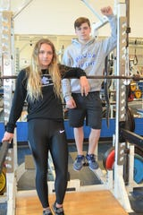 Harper Creek's Shelby Grable and Logan McNeil both finished in the top 10 at the recent high school powerlifting state finals.