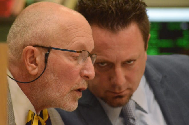 Attorney Randall Levine, left, speaks with Edwin Richards.
