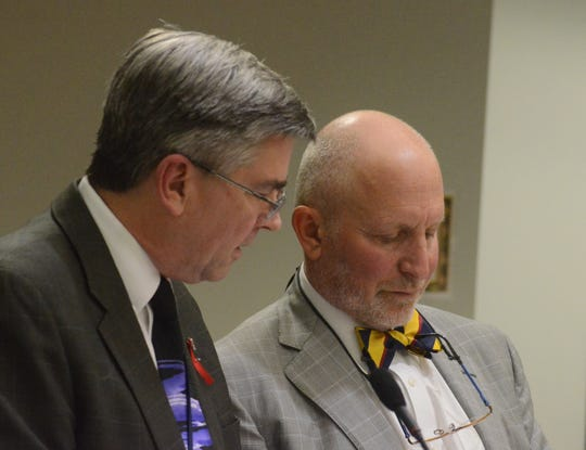 Calhoun County Prosecutor David Gilbert, left, and attorney Randall Levine confer during the hearing.
