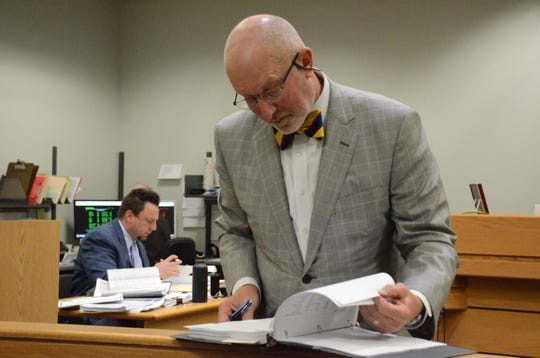 Attorney Randall Levine reviews some of the thousands of pages of documents introduced in the case.