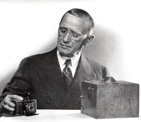 Carl Bormann, early leader of Ansco, looking at Binghamton-made cameras, about 1935.