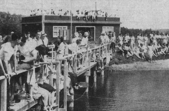 Workers and families enjoy the day at Ansco Lake in summer 1941.