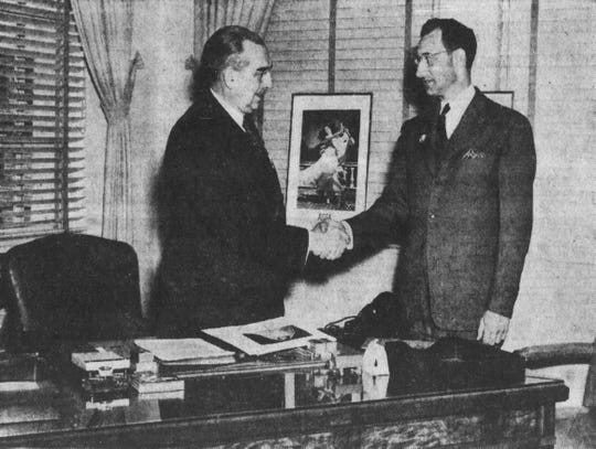 Albert Marshall, new head of the Ansco plant in 1942, is greeted by Fred Berry, president of the Photographic & Chemical Works Union.
