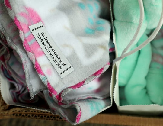 Tags adorn each handmade blanket in memory of Hudson David Kanzler, who was born stillborn on April 25, 2017, at Harrison Medical Center in Silverdale.