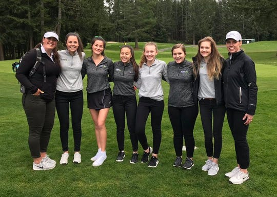 Klahowya's girls golf team beat North Mason to secure the Olympic League title on Tuesday at Gold Mountain Golf Club.