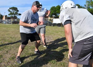 New Melbourne football head coach Tony Rowell watches his players during spring football practice at Melbourne High School.