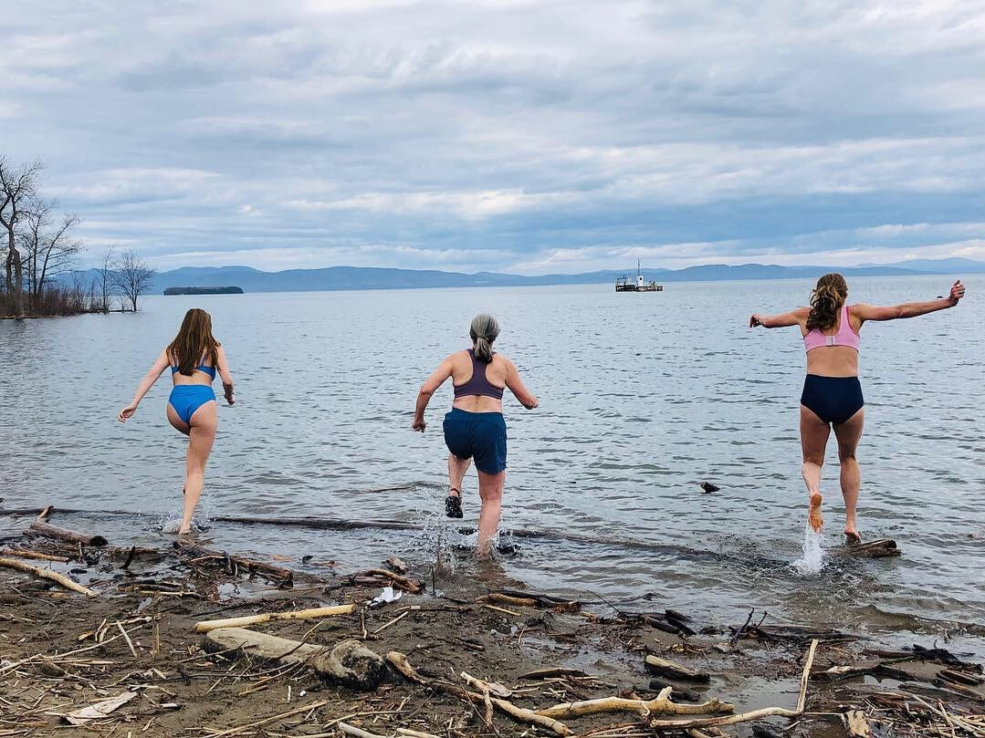 Burlington artist Katharine Montstream, right, jumps into Lake Champlain with her friend, Mima Tipper (center) and daughter, Sylvie Dworshak, at Oakledge Park on March 17, 2019.
